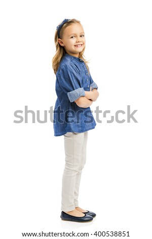 Studio portrait of a cute blonde girl, isolated in white background