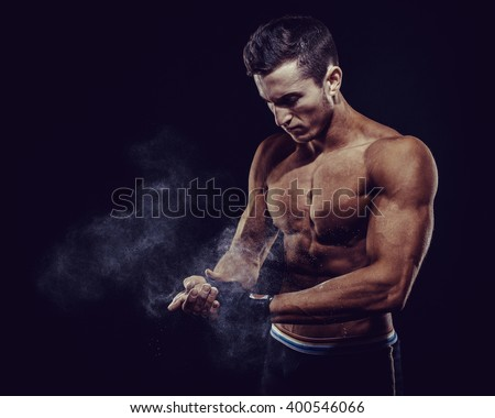 MMA Fighter Preparing Bandages For Training. Dark background Royalty-Free Stock Photo #400546066