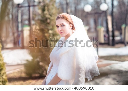 Portrait of beautiful bride. Wedding dress. on the background of nature #400590010