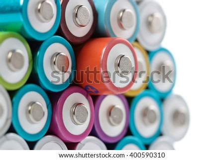Several AA batteries in perspective closeup view on white background #400590310