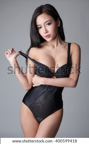 Sexy asian girl wearing black one piece lingerie isolated on white background #400599418
