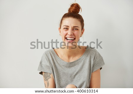 Happy woman Laughing. Closeup portrait woman smiling with perfect smile and white teeth looking laugh loudly isolated grey wall background. Positive human emotion facial expression body language.  #400610314