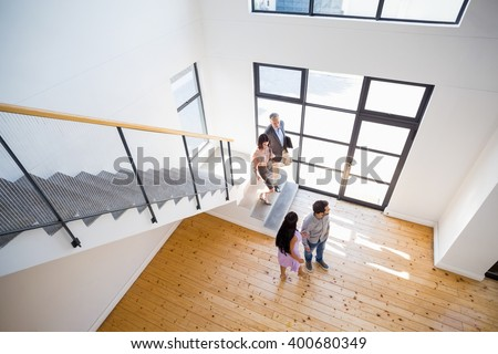 Real estate agent showing new house to couple #400680349