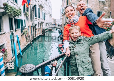 Madly happy family take a selfie photo on the one of bridge in Venice