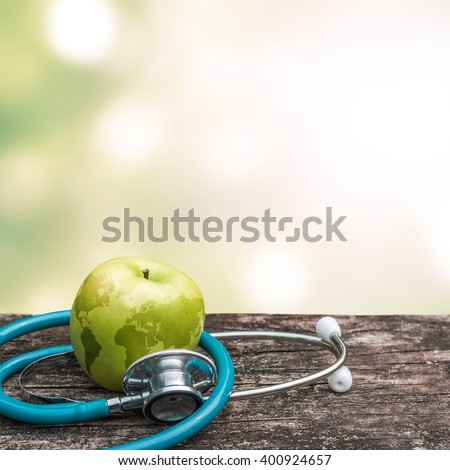 World health day and National Food Safety Education Month symbolic concept with map on healthy nutritional apple antioxidant fruit with doctor's stethoscope  #400924657