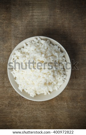 Cooked rice isolated on wooden background #400972822
