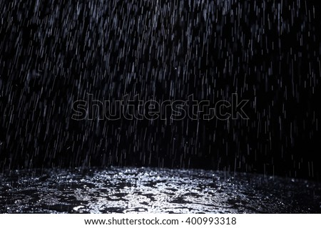 Dark background shot of rain falling