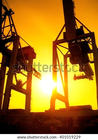 Hamburg Harbor in the sunrise or sunset. Freight shipping cranes. #401019229