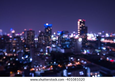 Abstract urban night light bokeh defocused background #401081020