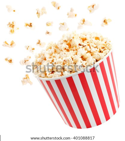 Popcorn in red and white cardboard box is shaking Royalty-Free Stock Photo #401088817