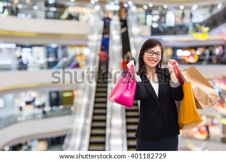 Beautiful and happy Asian girl shopping in mall #401182729
