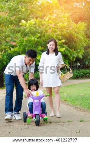 Asian family enjoying outdoor nature in the park #401222797