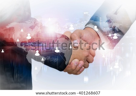 Double exposure of businessman handshake on industrial business background, connections concept, Elements of this image furnished by NASA. Royalty-Free Stock Photo #401268607