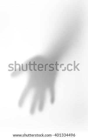 The concept of the shadow of hand behind frosted glass illuminated from behind. #401334496