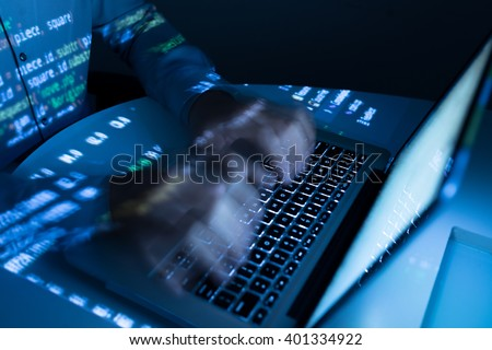 Hands of coder typing very fast, blurred motion Royalty-Free Stock Photo #401334922