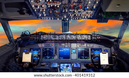 airplane cockpit Flight Deck in sunset Royalty-Free Stock Photo #401419312