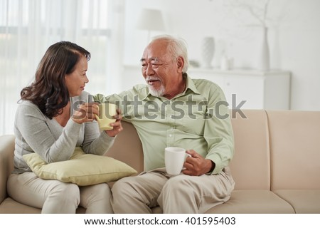 Asian aged couple drinking tea and chatting at home #401595403