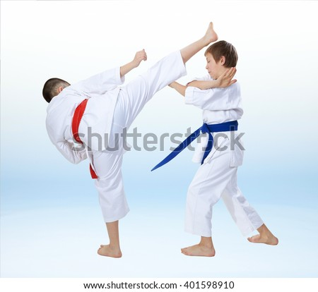 Children are training karate techniques on a light background #401598910