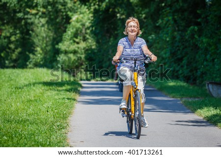 Senior woman with her bike #401713261