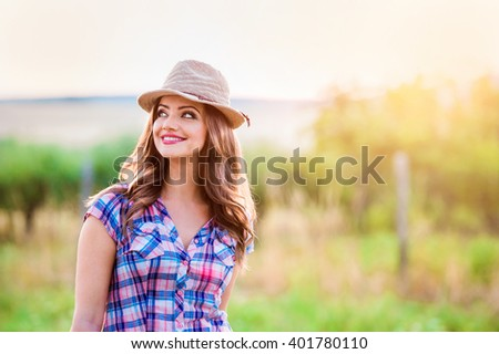 Gardener in checked shirt and hat, green sunny nature #401780110
