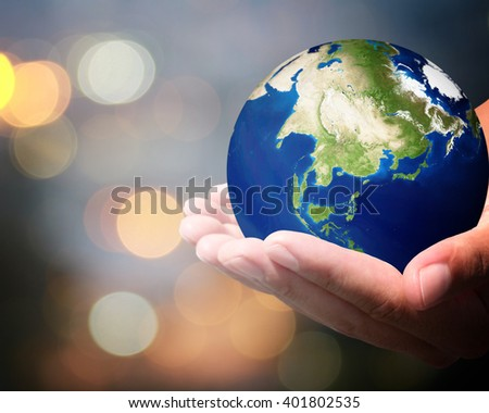 The world is on hold for the city bokeh blur background. earth social in human the hand. Businessman holding planet Earth in palm. Elements of this image furnished by NASA. #401802535