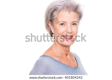 Smiling senior woman in front of white background #401804242