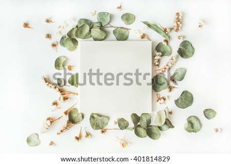 white wedding or family photo album, frame with dry and fresh branches isolated on white background. flat lay, overhead view