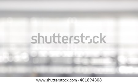 Blur abstract background interior view empty office lobby with entrance doors and glass curtain wall