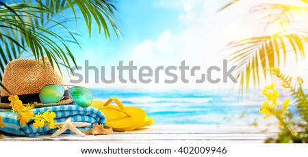 Straw hat, towel, sun glasses and flip flops on beach #402009946