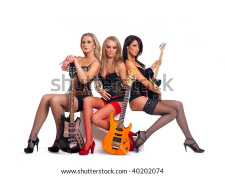 Sexy female music band isolated on white #40202074