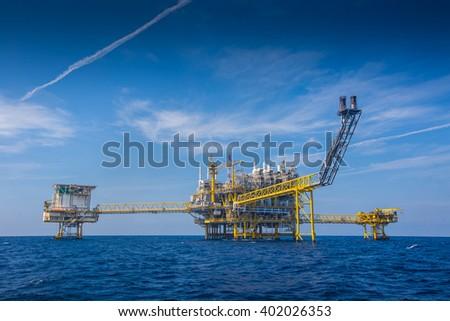Oil and gas processing platform at center, wellhead platform at right, flare platform in front of processing platform and accommodation platform at left. #402026353