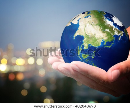The world is on hold for the city bokeh blur background. earth social in human the hand. Businessman holding planet Earth in palm. Elements of this image furnished by NASA. #402043693