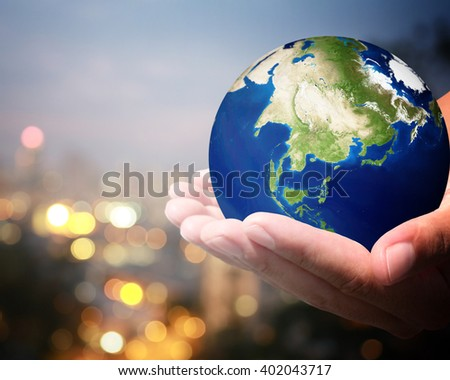 The world is on hold for the city bokeh blur background. earth social in human the hand. Businessman holding planet Earth in palm. Elements of this image furnished by NASA. #402043717