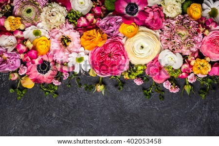 Various flowers on black background. Overhead view with copy space #402053458