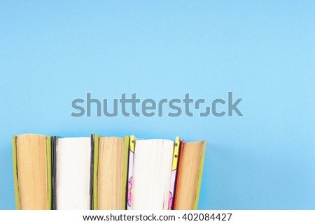 Vintage old books on  light background. Books and reading are essential for self improvement, gaining knowledge and success in our careers, business and personal lives. #402084427