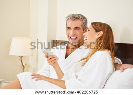 Happy couple laughing during holiday stay in hotel room #402206725