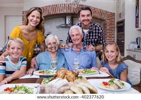 Portrait of multi-generation family having meal at home #402377620