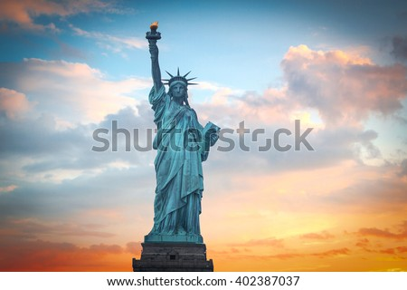 Statue of Liberty on the background of colorful dawn sky Royalty-Free Stock Photo #402387037