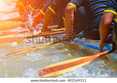 rowing team race and color tone effect Royalty-Free Stock Photo #402569311