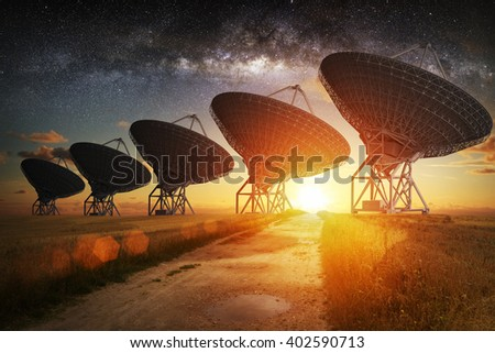 Satellite dish view at night with milky way in the sky Royalty-Free Stock Photo #402590713