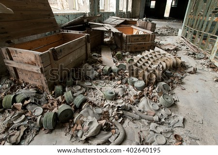 abandoned gas masks on the floor of the school in the town of Pripyat #402640195