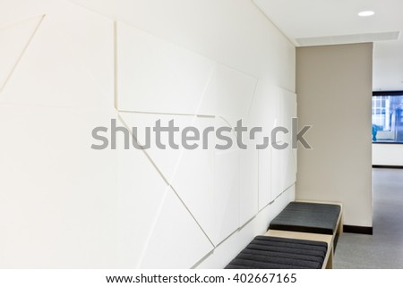 Creative wall art design close up over chairs in a modern room with lights on #402667165