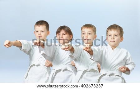 Children are hitting a punch arm on a light background #402673237