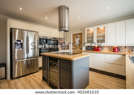 Modern Kitchen with Island / A modern domestic kitchen with high gloss units, rounded corners and an island #402681610