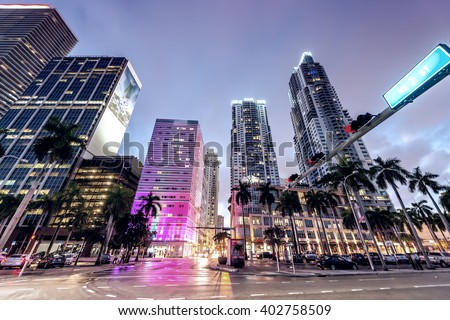Streets and Buildings of Downtown Miami at night. Royalty-Free Stock Photo #402758509