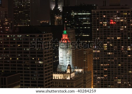Wrigley Building in downtown Chicago, displaying Halloween colors on the clock tower