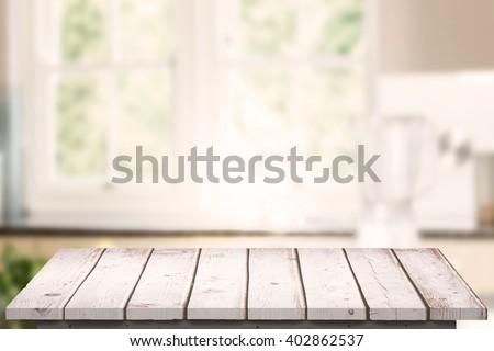 Wooden floor against empty kitchen with vegetables #402862537