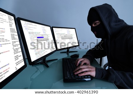 Hacker Stealing Data On Multiple Computers And Laptop #402961390