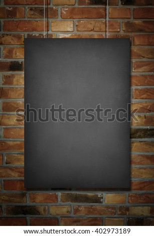 Blank blackboard at a brick wall background with space for text #402973189
