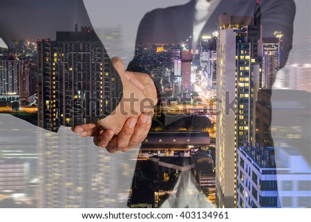 Double exposure of business women double handshake, night street and night city on motion background as welcome and congratulation concept. #403134961